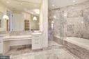 Spacious primary bath with wall to wall marble - 1881 N NASH ST #2311, ARLINGTON