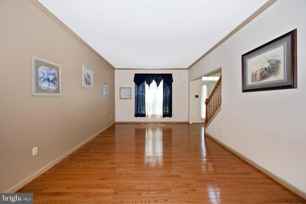 Spacious living room from the Dining area - 6904 BARON CT, FREDERICK