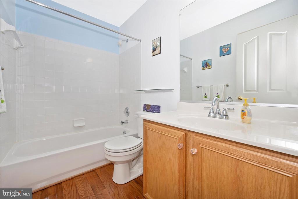 Hall Bathroom with dual sinks - 6904 BARON CT, FREDERICK