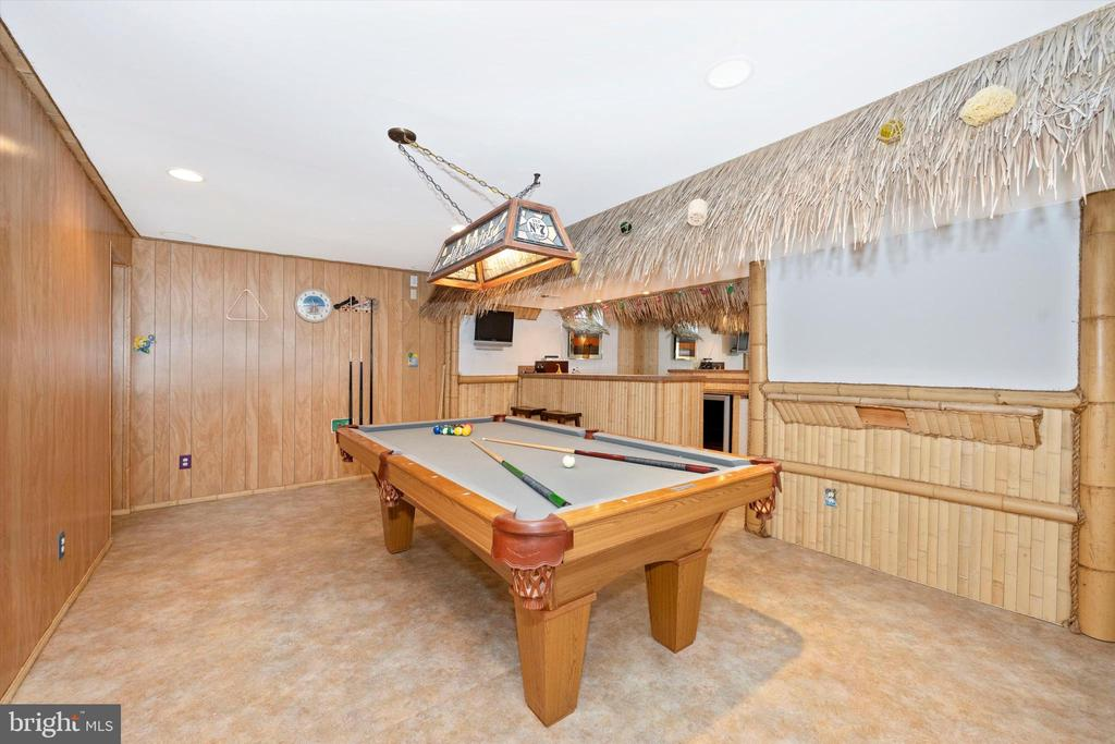 Play pool while enjoying a drink at your tiki bar - 6904 BARON CT, FREDERICK
