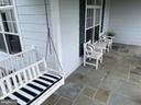 Porch with swing and plenty of outdoor seating - 14868 CIDER MILL RD, HILLSBORO