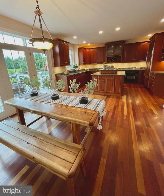 View of kitchen from family room - 14868 CIDER MILL RD, HILLSBORO