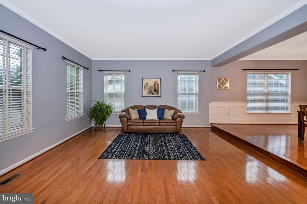 Formal living room with stunning hardwood - 6304 SPRING FOREST RD, FREDERICK