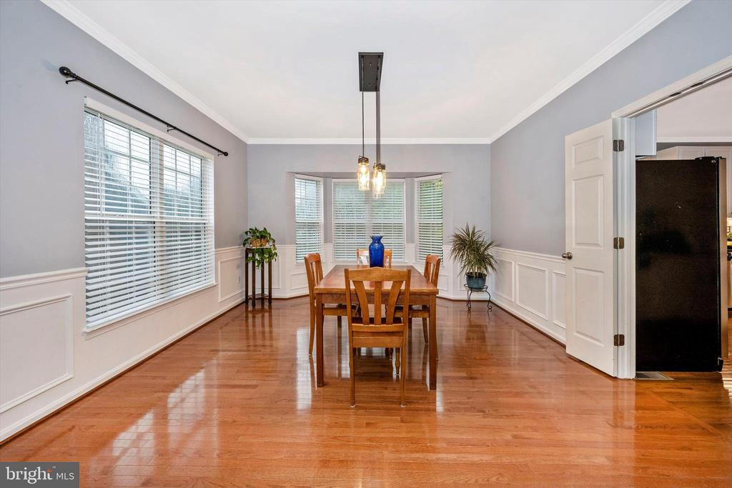 Gorgeous hardwood and updated lighting Din Rm - 6304 SPRING FOREST RD, FREDERICK