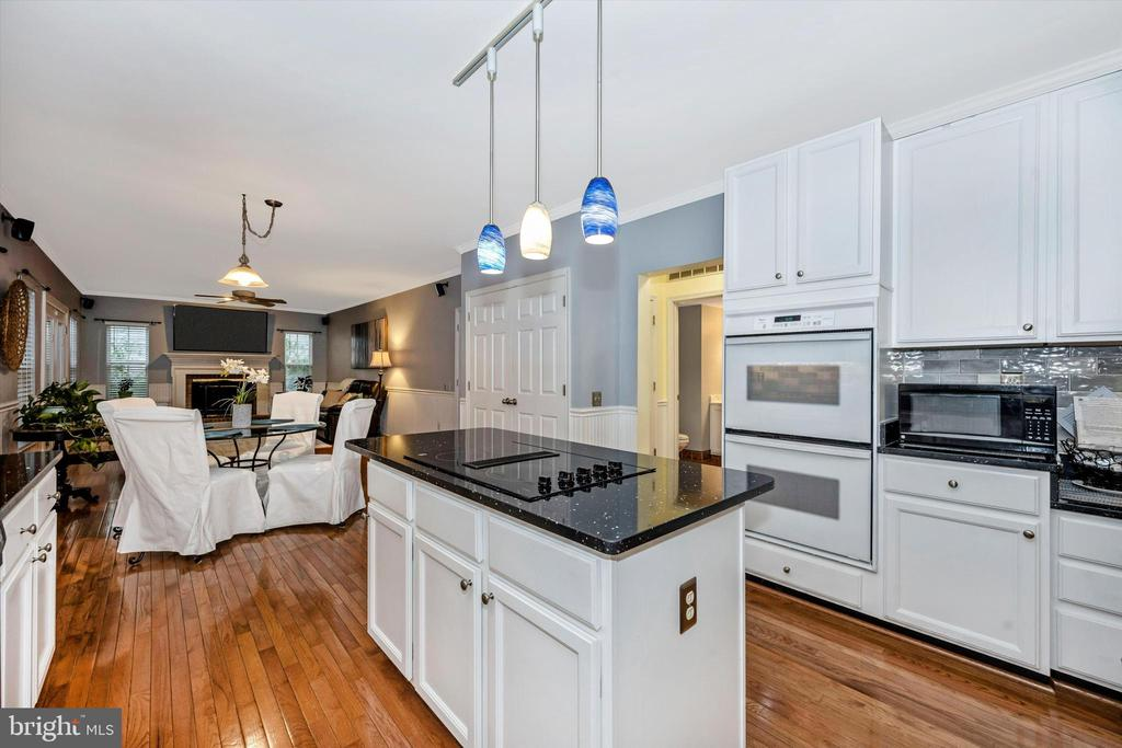 Kitchen with open floorplan to family room - 6304 SPRING FOREST RD, FREDERICK