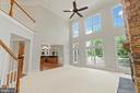 Floor to ceiling windows overlook private yard - 43409 RIVERPOINT DR, LEESBURG
