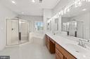 Primary bath w/dual sink vanity & heated bidet - 43409 RIVERPOINT DR, LEESBURG