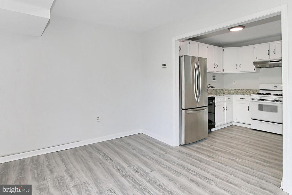 Flows into kitchen - Brand new LVF throughout! - 6137 LEESBURG PIKE #602, FALLS CHURCH