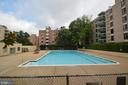 Community pool tucked away in a nearby courtyard - 6137 LEESBURG PIKE #602, FALLS CHURCH