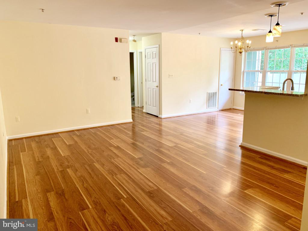 View from entrance of family room and dining area - 501 CONSTELLATION SQ SE #C, LEESBURG