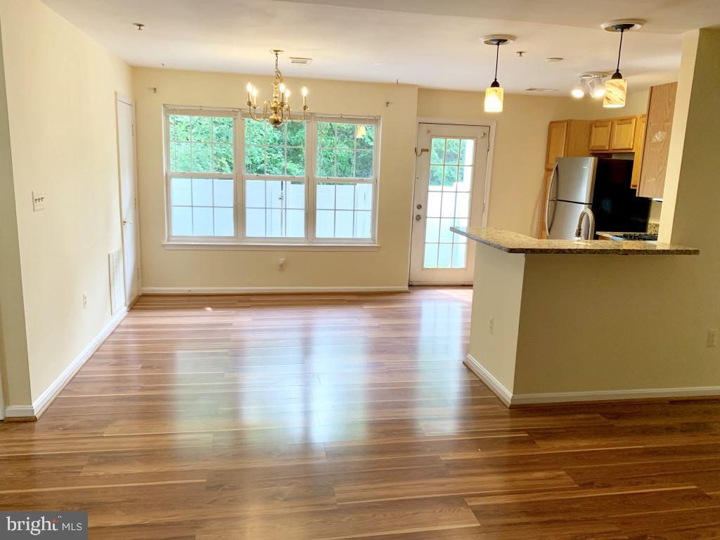 Gleaming floors throughout. Lots of natural light! - 501 CONSTELLATION SQ SE #C, LEESBURG