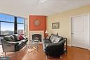 Living room with gas fireplace. - 1021 N GARFIELD ST #731, ARLINGTON