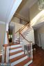 Refinished elegant staircase - 22554 FOREST RUN DR, ASHBURN