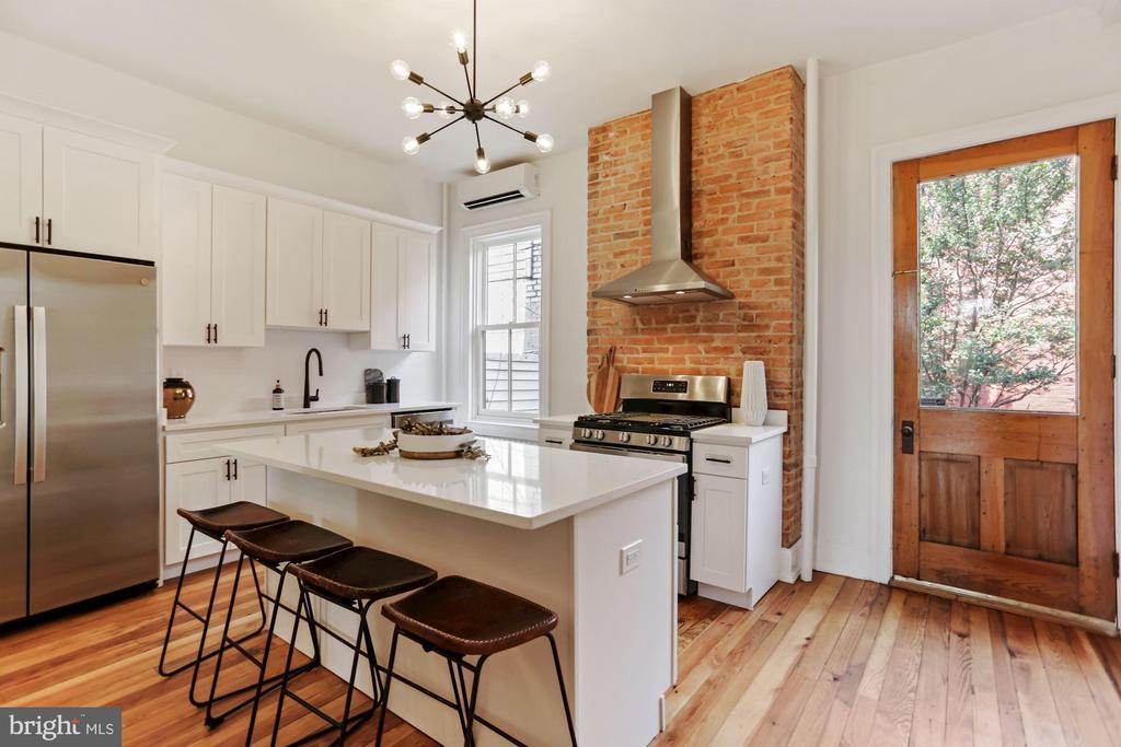New kitchen w/original 8' door and exposed brick - 1838 VERMONT AVE NW, WASHINGTON