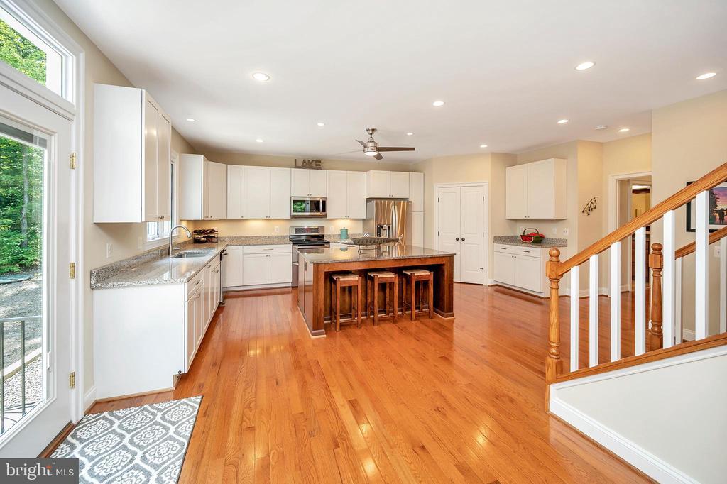 doors to patio-view to kitchen-upper stairwell - 108 BEACHSIDE CV, LOCUST GROVE