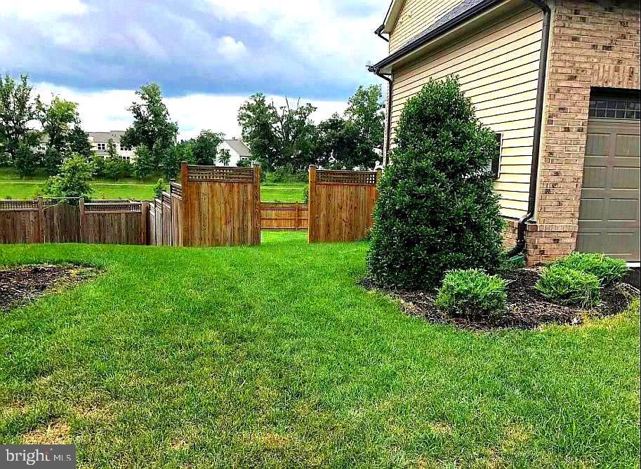 Yard Fully Fenced - 23384 MORNING WALK DR, BRAMBLETON