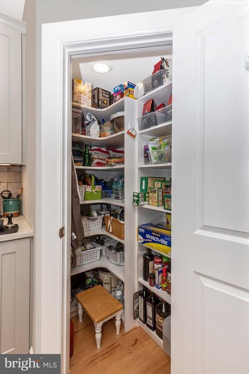 Custom closet organizers in spacious corner pantry - 3835 FULHAM RD, FREDERICK