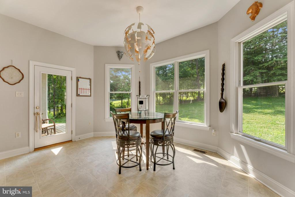 Breakfast nook with large windows - 4346 BASFORD RD, FREDERICK