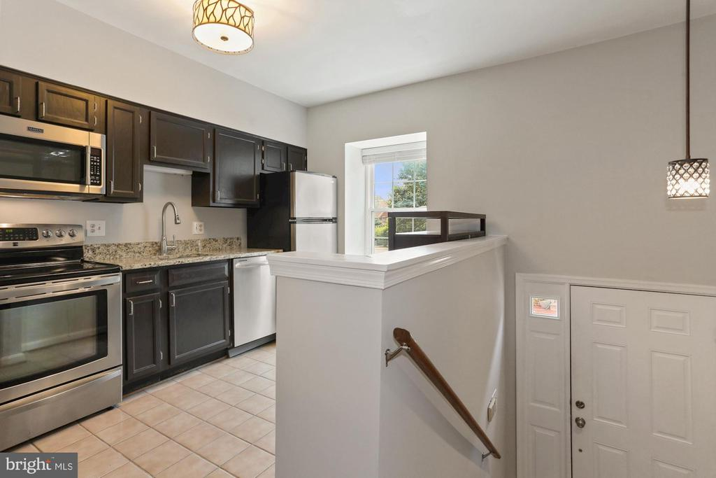 Kitchen with tile and stainless steel appliances - 920 S ROLFE ST, ARLINGTON