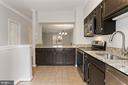Kitchen opens into dining room and living room - 920 S ROLFE ST, ARLINGTON
