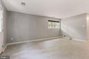 Rec space with updated tile floors - 920 S ROLFE ST, ARLINGTON