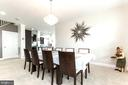 Formal dining room perfect for special occasions - 23384 MORNING WALK DR, BRAMBLETON
