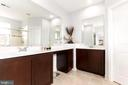 Owners En-suite bath and walk-in closets. - 23384 MORNING WALK DR, BRAMBLETON