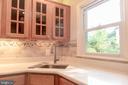 Gorgeous maple cabinets and new tile. - 1220 S BUCHANAN ST, ARLINGTON