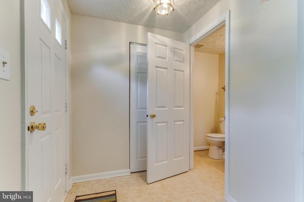Entry Foyer w/ coat closet and powder room - 3594 WHARF LN, TRIANGLE