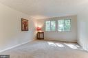 Primary bedroom overlooks mature trees - 3594 WHARF LN, TRIANGLE