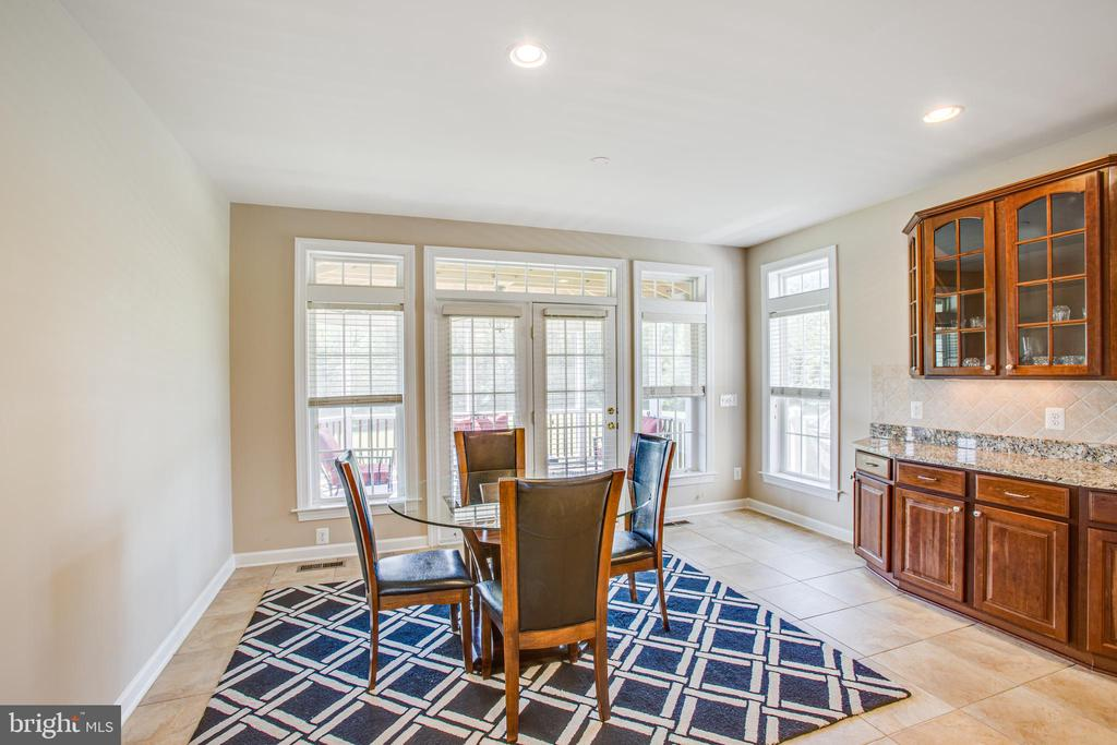 Doors lead to fabulous screened in deck! - 57 SNAPDRAGON DR, STAFFORD