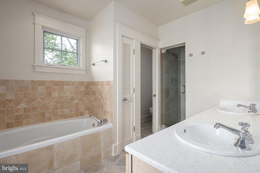 Primary bathroom with steam shower and dual sinks - 1611 N BRYAN ST, ARLINGTON