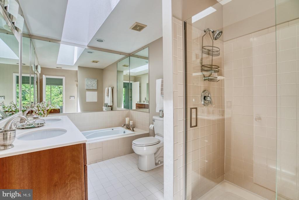 Primary Bathroom has glass shower & soaking tub - 2211 CEDAR COVE CT, RESTON
