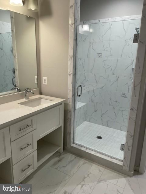 MASTER BATH. DOUBLE SINKS AND DELUXE SHOWER W BENC - 1955 ROLAND CLARKE PL #29, RESTON