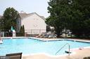 Enjoy a dip in the community pool - 12236 LADYMEADE CT #5-201, WOODBRIDGE
