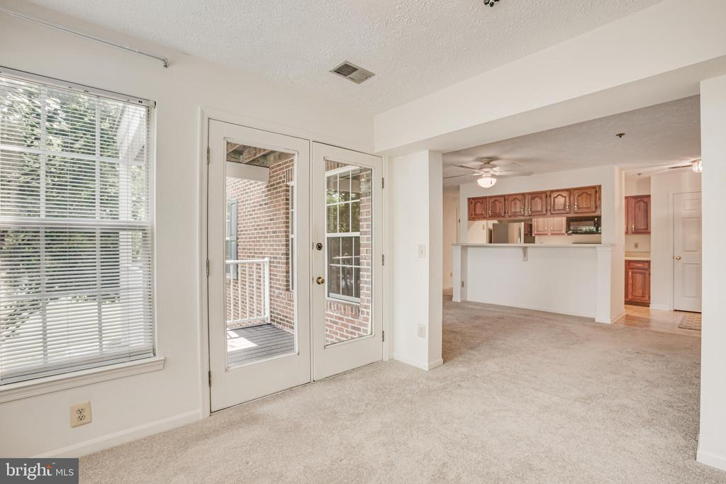 The French door leads to your private deck - 12236 LADYMEADE CT #5-201, WOODBRIDGE
