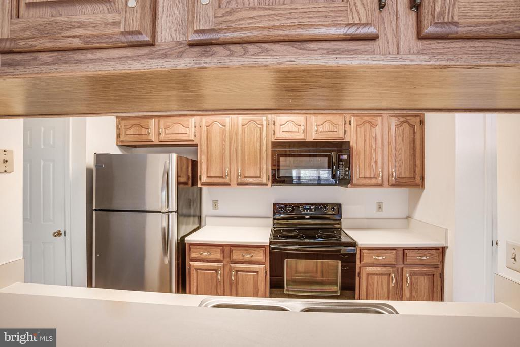Storage cabinets galore in the kitchen! - 12236 LADYMEADE CT #5-201, WOODBRIDGE