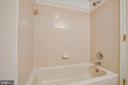 Guest bathroom features a combo tub and shower - 12236 LADYMEADE CT #5-201, WOODBRIDGE
