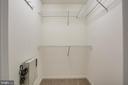 Large walk-in closet in primary bedroom - 12236 LADYMEADE CT #5-201, WOODBRIDGE