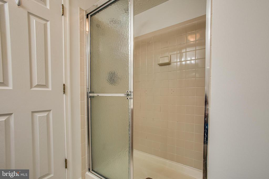 Primary bathroom features a tiled shower - 12236 LADYMEADE CT #5-201, WOODBRIDGE