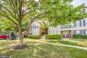 Notice the grounds are well kept by the community - 12236 LADYMEADE CT #5-201, WOODBRIDGE