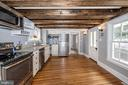 kitchen features wood floor and lots of light - 123 W 5TH ST, FREDERICK