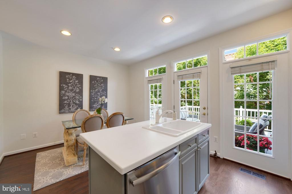 Kitchen opens to Dining Room & Deck - 12079 CHANCERY STATION CIR, RESTON