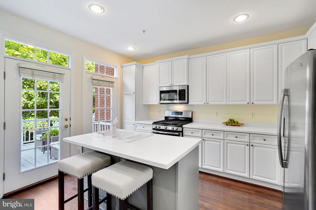 Bright & White Kitchen with Custom Painted Island - 12079 CHANCERY STATION CIR, RESTON