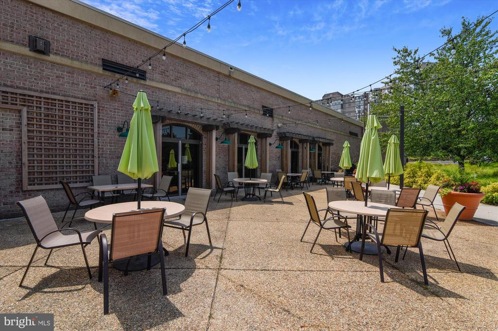 Clubhouse patio for outdoor concerts and more! - 19375 CYPRESS RIDGE TER #904, LEESBURG
