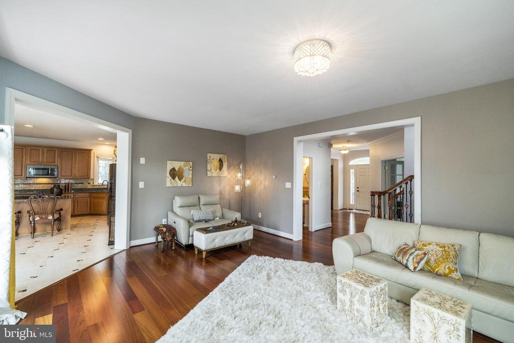 Flowing rooms with All Wide Planked Wood Floors - 23084 PECOS LN, BRAMBLETON