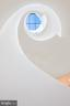 Modern helical staircase - 1120 GUILFORD CT, MCLEAN