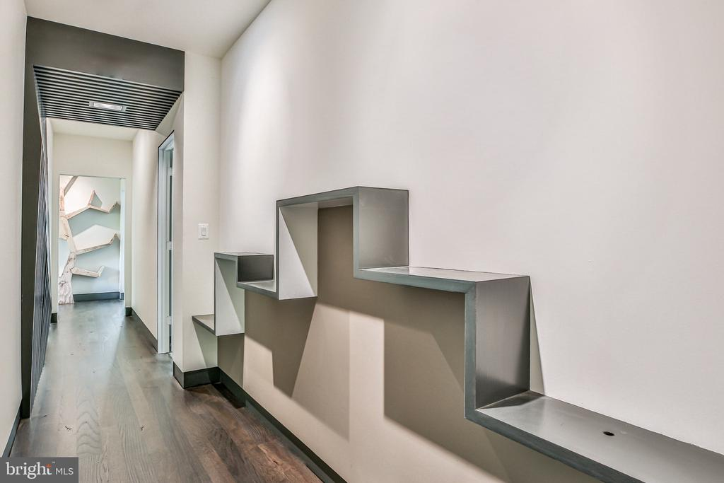 Display shelving in hallway niches - 1120 GUILFORD CT, MCLEAN