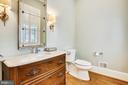 Main level powder room located off  foyer - 3038 N PEARY ST, ARLINGTON