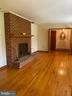 Formal living room with brick fireplace - 704 APPLE PIE RIDGE RD, WINCHESTER